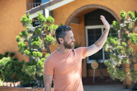 Portrait of handsome man standing outside new home. Stock Photo