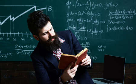 University male speaker conducts training. Awesome teachers know about things that make students curious. Professor teacher at the classroom in a school.