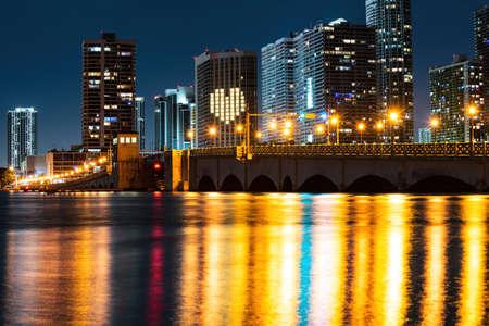 Miami skyline panorama with urban skyscrapers. Miami city night.