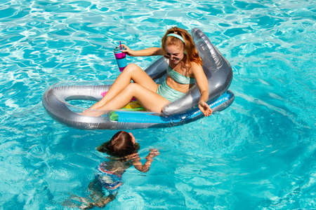 Active lifestyle. Boy with mother at aquapark. Swim in swimming pool. Family summer vacation. Pool party.