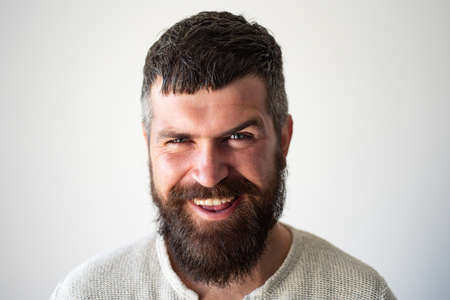Happy smiling bearded man portrait. People emotions, face exspression.