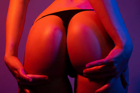 Sexy butt girl in lingerie. Luxury ass. Huge buttocks. Night background. Beautiful of sensual girl with clean skin, nice shapes, fit bottom, intimacy. Sexy girl and underwear concept.