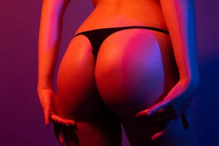 Sexy butt, sensual ass, in bikini, thong lingerie close up.