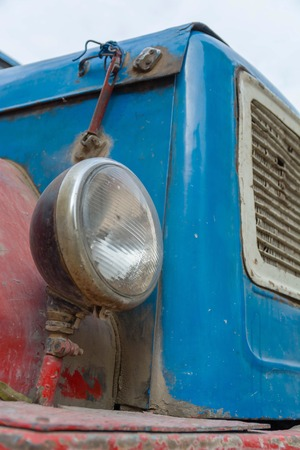 Vintage rusty red truck car with a old headlight, soft focus Stock Photo