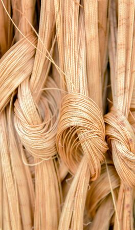 close up shot of texture detail. vertical thread tied to a node in the background. Stock Photo