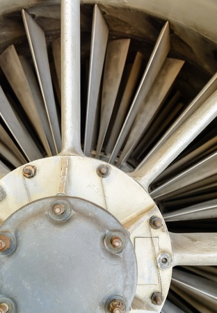 private parts: turbine blades and inside a close-up of a jet engine military plane. Technical background