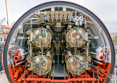Detailed view of torpedo room in old submarine. Stock Photo