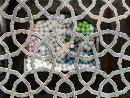 grille: Openwork ventilation grille in oriental style. Detail of the house. Stock Photo