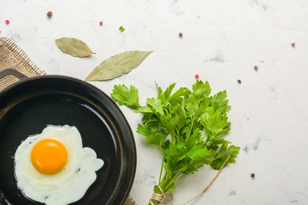 Morning in the kitchen. Cooking breakfast. Fried egg. Light background and place for text.