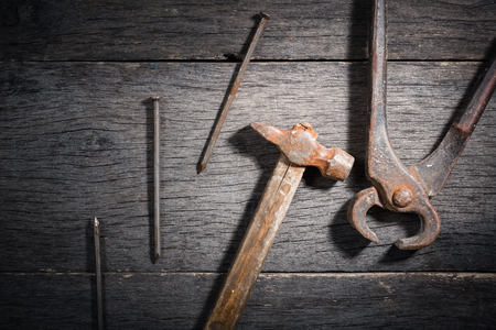 very dirty: Old locksmith tools on a gray and cracked wooden background. Space for text. View from above.