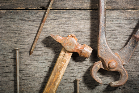 rusty nail: Old locksmith tools on a gray and cracked wooden background. Space for text. View from above.