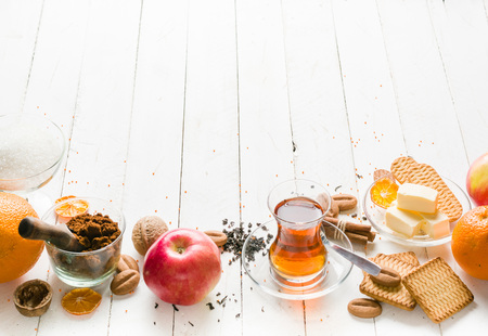 white backing: Morning tea with fruit and candied fruit. White wooden background and place for text. Stock Photo