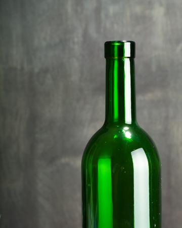 degustation: High wine glass made from green glass. No content. Low key. Stock Photo