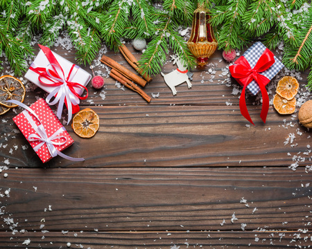 Dark Christmas background. Gifts and congratulations on the New Year. Family meeting. Copy space. Stock Photo