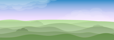 Spring vivid landscape with hills, grass and sky. Clouds, fog and shadows. Seasons of the year spring or summer