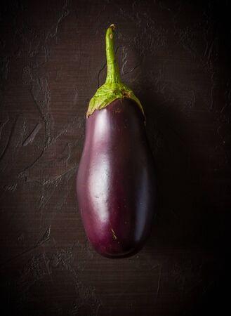 Fresh eggplant on a dark slate background. Summer vegetable