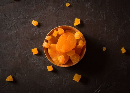 Delicious and healthy dried apricots. Freshly dried. On a dark background. Reklamní fotografie