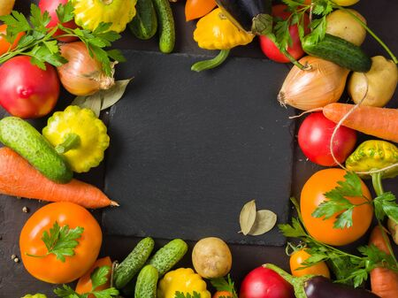 Fresh summer vegetables on the kitchen table. Lay out in the form of a frame for placement inside the text, recipe or photo Reklamní fotografie