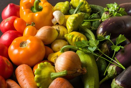 Summer vegetables of different colors. The alternation of colors in a rainbow. For salad or for a vegetable dish