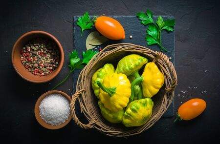 Yellow and green squash lying on a dark kitchen table. Seasonings and spices for cooking Reklamní fotografie