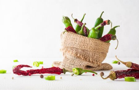 A variety of green hot peppers in a small bag. Seasoning for a delicious dish. Copy space. Stok Fotoğraf - 130137023