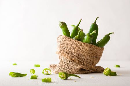 A variety of green hot peppers in a small bag. Seasoning for a delicious dish. Copy space. Stok Fotoğraf - 130137051