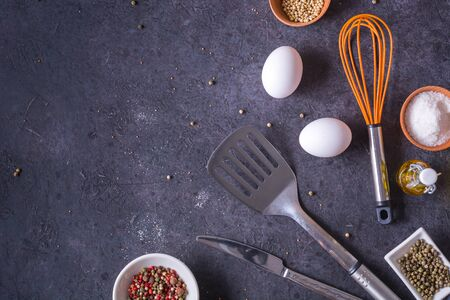 Fresh chicken eggs lying on a dark table. Plenty of room for text. cooking breakfast or eggs