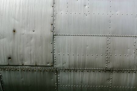 Aluminum sheet and rivet fastening. Aviation background. Copy space.