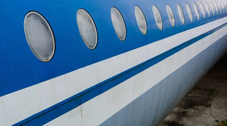 A number of perspective portholes of a passenger plane in blue and white
