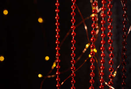 Vertical red Christmas tree garlands. Decoration for Christmas. Ghost lights. Stock fotó