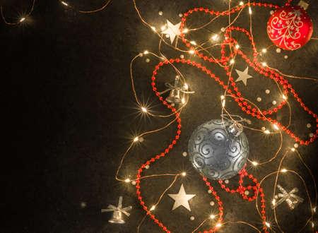Christmas background for postcards. LED garland on a dark background. Stock fotó - 159990992