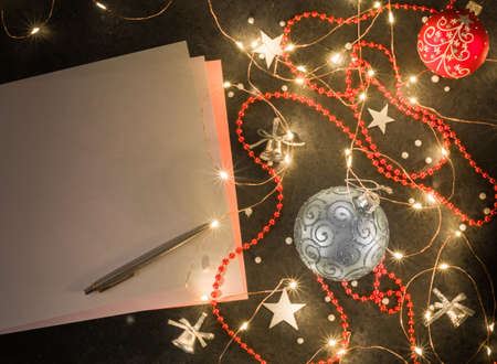 Preparation for New Years or Christmas greetings. Dark background, girlyadna and christmas decorations.