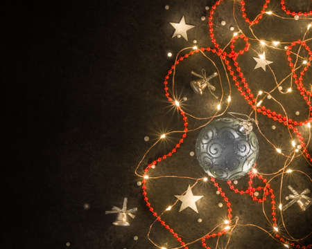 Christmas background for postcards. LED garland on a dark background.