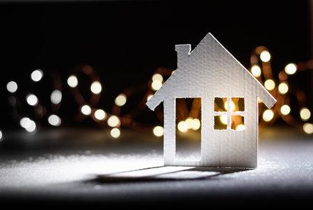 Small cardboard house on a dark winter background. Stock fotó - 160426863