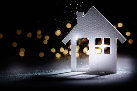 Small cardboard house on a dark winter background. Stock fotó - 160426868