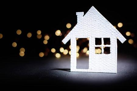 Small cardboard house on a dark winter background. Stock fotó - 160426871