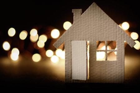 Small cardboard house on a dark winter background. Stock fotó - 160426872