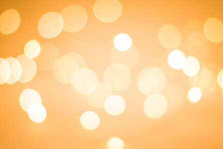 Blurry bright lights of varying sizes and intensities. Lively holiday cover design.