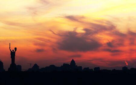known: Kiev skyline with beautiful yellow sky at sunset