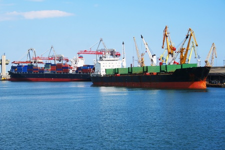 Shipping cargo onto barges in Odessa port. Stock Photo - 11419472