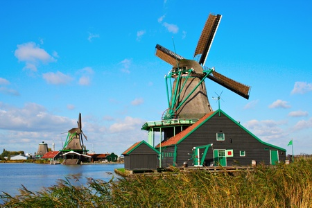Windmills used for manufacturing of different products in Zannse Schans, Holland photo