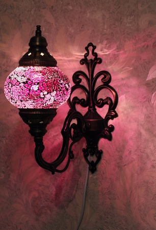 Turkish handmade pink lamp on the wall Stock Photo