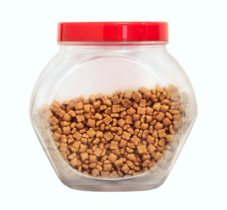 Cat food in glass jar isolated on white photo