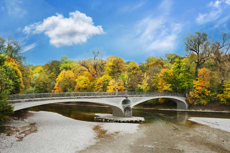 Lonely stone bridge over autumnal scene in Munich Stock Photo - 12424866