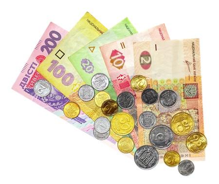 白い背景上に分離されてそれらの上にコイン hryvnya と呼ばれるウクライナのお金