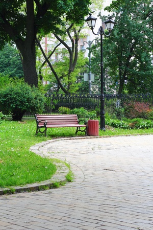 Pavement road leading to the bench in Mariinsky Park in Kiev Stock Photo - 13702060