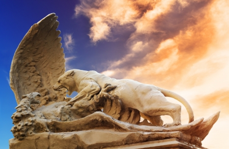 Battle of lioness and eagle. Statute near House with Chimeras in Kiev Stock Photo