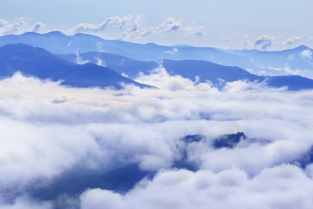 Aerial view on Carpathian mountains covered with clouds