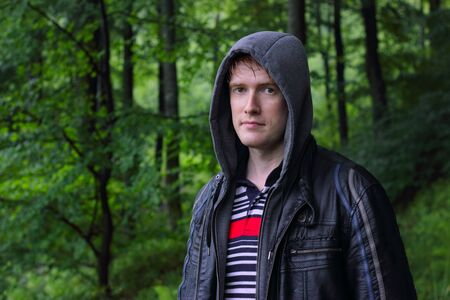 Portrait of a young man hiking in the forest Stock Photo - 14357543