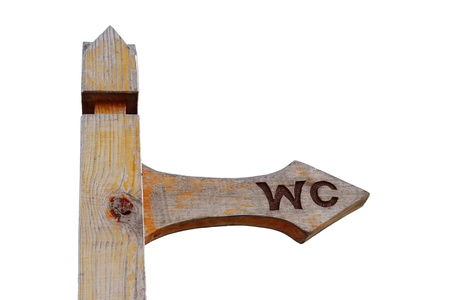 Wooden arrow WC sign isolated on white background photo